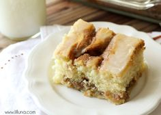 Cinnamon Roll Cake - one of the most delicious things you'll ever make! { lilluna.com } So moist and full of cinnamon flavor!!
