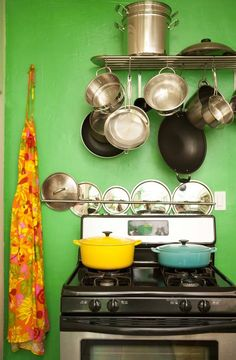 Pots and Pans in a tiny green kitchen.