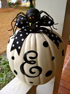 Monogram & Polka dot white pumpkin with Polka dot ribbon. Use a fake pumpkin so you can use it year after year.