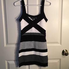 Striped, rayon black, grey and white dress Love the material. Soft and fits so nicely. This dress is appropriate for a number of occasions Forever 21 Dresses Mini