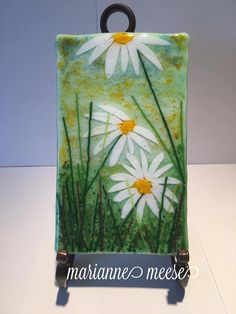 Handmade fused glass panel 4 1/2 x 7 1/2 with a Daisy design. Stand not included.