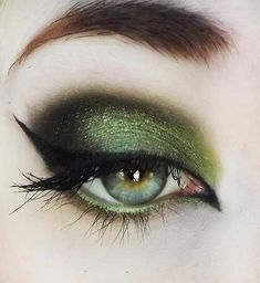 Olive green metallic smokey eye for green and blue eyes with a winged black eyeliner.