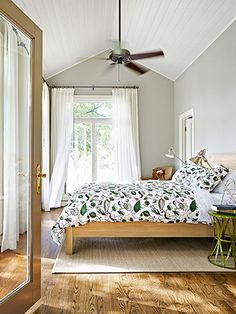 A botanical-themed duvet cover by Dwell Studio tops a Crate & Barrel bed in this open and airy bedroom.