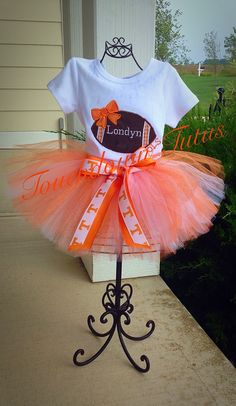 A personal favorite from my Etsy shop https://www.etsy.com/listing/247011643/tennessee-inspired-tutu-outfit-or-pick