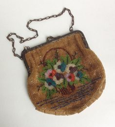 Antique Victorian Floral Hand Beaded Purse. Hideous frame but nice arts and craftsy design basket of flowers
