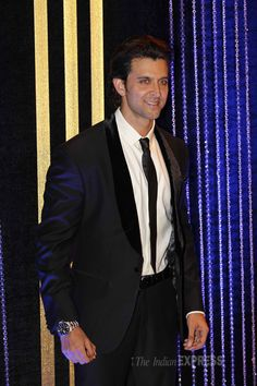 Hrithik Roshan looking suave in a suit and tie at father Rakesh Roshan's birthday bash. #Bollywood #Fashion #Style