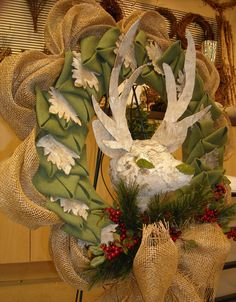 I used birch bark for the leaves and deer head on a mixed burlap wreath.