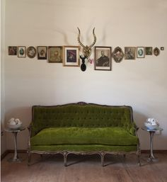 vintage \ green velvet sofa \ traditional \ antique \ gallery wall \ eclectic \ upholstery \ living room \ styling \ living room
