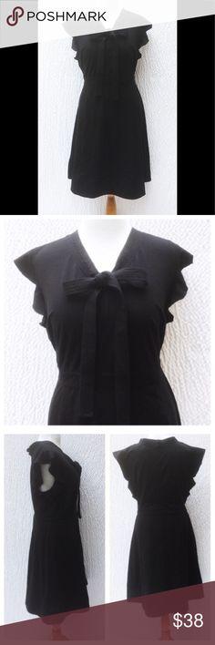 "New Eshakti Black Fit & Flare Dress 24W New Eshakti black knit fit & flare dress 24W Measured flat: underarm to underarm: 49"" Empire waist: 46"" Length: 43"" Eshakti size guide for 24W bust: 51"" V neck, front tie, bodice darts.  Back hidden zipper, two button back neck closure. Banded waist, flared skirt w/side seam pockets, banded hem. Cotton/spandex, woven jersey knit, light stretch. Machine wash. New w/cut out Eshakti tag to prevent returning to Eshakti. eshakti Dresses"