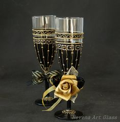 HAND PAINTED Champagne Flutes, Wedding Glasses, set of 2. Geometric gold glitter pattern.Soft black frost effect on the glass surface. Fabric decoration on the stem and base. Perfect choice for Gatsby style wedding party, great for black and gold themed wedding. Unique wedding or anniversary gift. One of a kind glasses, free hand painting, author design. READY TO SHIP! Height 21cm 8.5 15cl / 5 oz Gift box pack ! To Personalized these glasses: I can paint your names on the base of th...