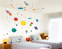 Space wall decals - love how they go up the wall and onto the ceiling. Smart.
