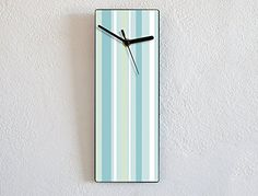 Blue Lines Pattern - Wall Clock. ❂ 3mm thick black mat acrylic face with high quality printed vinyl on it ❂ My clock mechanisms are EZ Quartz® Sweep (Non Ticking - Silent) and RoHS Approved! ❂ Requires 1 AA battery (not included).