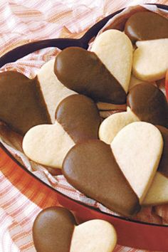 Be-My-Valentine Cookies: Kick your baking game up a notch by dipping your cookies in chocolate—yum! Click through for more decorated Valentine's Day cookie recipes easy to make for him, kids, and the rest of your family.