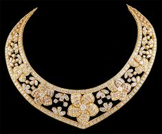 """VAN CLEEF & ARPELS Diamond Gold Necklace. The V-shaped openwork band designed as a graduated series of circular-cut diamond and sculpted 18kt. gold flower blossom, spaced by circular, marquise and pear-shaped diamond clusters, to the circular-cut diamond trim, mounted in 18kt. gold, 15"""""""
