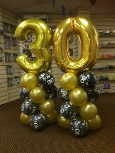 30th super-shape numbers in gold with black and gold latex tower