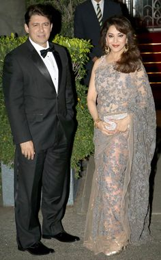 Madhuri Dixit accompanied by her husband Sriram Nene at a special dinner for British royal couple William and Kate. #Bollywood #Fashion #Style #Beauty #Hot #Saree