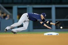 Just out of reach -  Shortstop Clint Barmes of the San Diego Padres dives but can't reach a single hit by Justin Turner of the Los Angeles Dodgers in the fifth inning at Dodger Stadium on May 22 in Los Angeles. - © Stephen Dunn/Getty Images