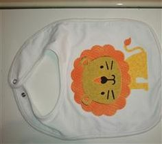 Cut the lion from CAC2 freebie in CCR at 6 inches out of fabric using Heat and Bond.  Ironed on to pre-made bib from Hobby Lobby.