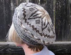 Knit from a range of natural-colored Shetland wools, this traditionally shaped tam features a corrugated ribbing, simple peerie bands for the body of the hat, and a star-patterned crown.