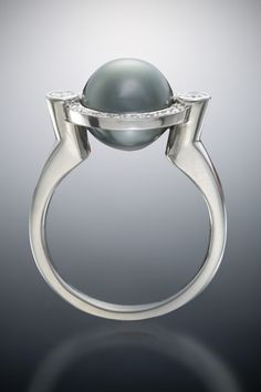 Lose not yourself in a far off time, seize the moment that is thine.  - Freidrich Schiller  Created by Christopher Duquet Fine Jewelry Design; Chicago;   Materials: White Gold, Diamonds, Black Pearl