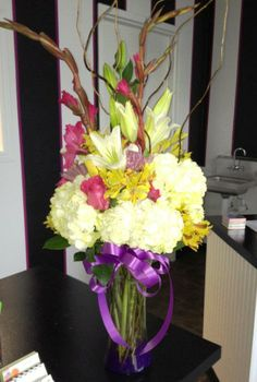 This long and lean floral machine was created using hydrangea, lilies, gladioli and curly will branches.