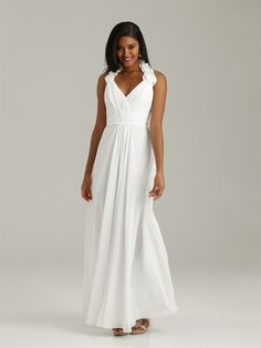 Soft ruffles adorn the halter neckline along the ruched bodice of this long, A-line style.