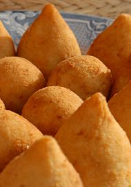 Sicilian Arancini - Deep-fried rice balls filled with meat sauce or mozzarella, ham and butter. The original amaze-balls!