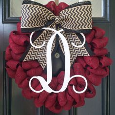 """Beautiful, custom garnet burlap wreath is created on a 16-18"""" wire wreath, complimented with a black (or black chevron) burlap bow and an Interlocking Vine single monogram. Perfect way to show your GAMECOCK pride - great for tailgates, baby / wedding showers, birthdays, housewarmings, ANY occasion!"""