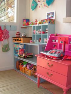 play kitchen. Good idea for shelves too. A great way to display stuff.