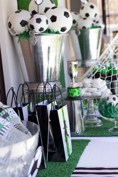 Soccer ball centerpieces in a fabulous silver bucket to look like a trophy!