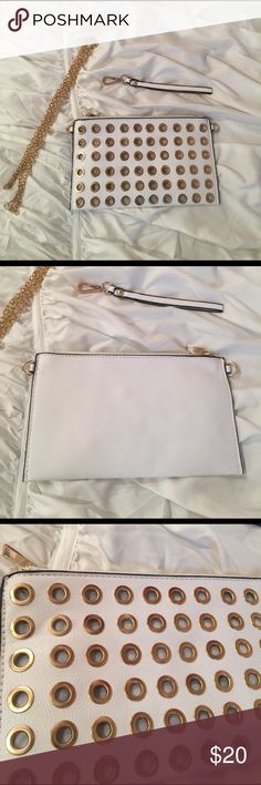 White and Gold Clutch Brand new still in packaging! Comes with a removable gold strap Bags Clutches & Wristlets