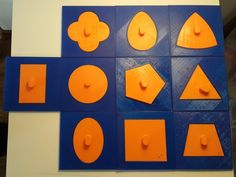 """Montessori """"metal"""" insets shapes created by my husband and his brother. You can 3D print them using the projects they published. The original Montessori color scheme is: pink for the frame and blue for the inset."""