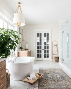 We love the look of marble tile in a master bathroom! 😍 What is your favorite type of flooring?We love the look of marble tile in a master bathroom! 😍 What is your favorite type of flooring?⠀ Design by Photo by Home Design, Mug Design, Bathroom Inspo, Bathroom Inspiration, Bathroom Ideas, Bathroom Colors, Colorful Bathroom, Bohemian Bathroom, Bathroom Trends