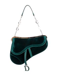 Emerald green velvet Christian Dior Evening Saddle bag with teal leather trim, silver-tone hardware, single interior wall pocket and top lock closure. Includes small mirror. Shop Christian Dior handbags on sale at The RealReal.