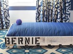 Shipping pallets were given new life as an adorable doggie bed with a soft cushion for easy resting. Design by Brian Patrick Flynn