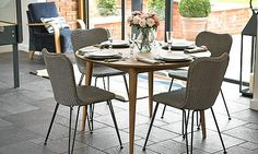 The contemporary Berlin dining table has a classic modernist design - straight legs, slimline top and smooth edges. It is made using recycled teak and finished with a matt water-based varnish to give some protection. Paired with the Berlin Lloyd loom dining chair it gives a clean modern look. There are also two rectangular tables in this range seating 6 to 8 and 8 to 10. £2335 round dining table and four dining chairs.