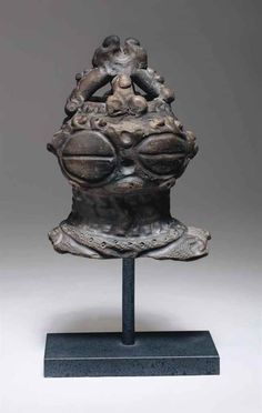 An earthenware head of a woman (Dogu)   LATE JOMON PERIOD (5TH - 3RD CENTURY BC)   Ancient Art & Antiquities, all other types of objects   Christie's