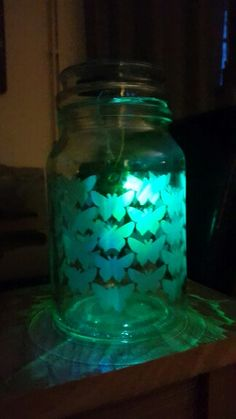 Upcycle douwe egberts coffee jar with solar light and butterfly etch