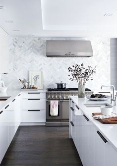 White kitchen in Mediterranean style Tap the link now to see where the world's leading interior designers purchase their beautifully crafted, hand picked kitchen, bath and bar and prep faucets to outfit their unique designs.