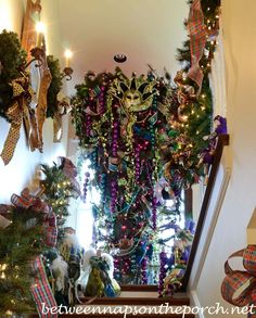 Upside down Christmas tree at the top of the stairs leading to the attic has a Mardi Gras theme in the Victorian home belonging to Governor Roy and Marie Barnes.