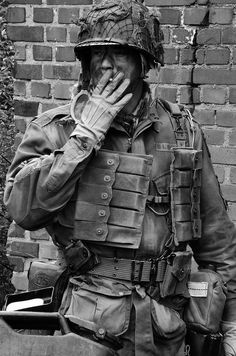 """CAVEAT: This is not a genuine wartime picture, usually incorrectly captioned """"Smoking—U.S. paratrooper in France 1944"""" or the like. Instead, it's a re-enactment photo by Floris Oosterveld taken in Bussum, Holland in 2012. Just click it for the correct attribution."""
