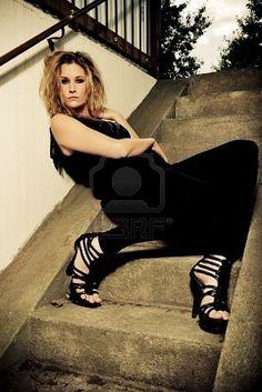 urban photoshoot idea #pose #allblack #boldshoes