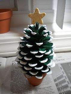 Pinecone Potted Christmas Tree-simple and inexpensive craft with multiple uses: kids, place card holder, package decor, etc. Could also do more sophisticated version with giant cones and metallic colors.