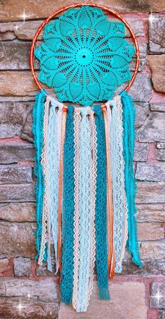 A personal favorite from my Etsy shop https://www.etsy.com/listing/253611306/bohemian-doily-dreamcatcher-in-lone