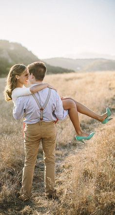 With a simple background and neutral colors, a bright pair of heels — and a pose like this to show them off — lets your personality come through.--Engagement photo ideas