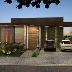 Casa com garagem lateral, porta em madeira e acabamento em concreto.