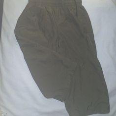 Nike Dri-fit sports capris Nike size woman's small grey sports capris. No issues, very light wash wear. Nike Pants Track Pants & Joggers