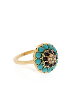 Our gold-plated Elizabeth cocktail ring is ornamented with faceted stones and sparkling crystal gems for a vintage-inspired look.