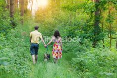 Young couple holding hands and walking with their dog in the forest Couple Holding Hands, Couples Walking, Young Couples, Happy Heart, Comebacks, Things To Come, Stock Photos, Couple Photos, Effort