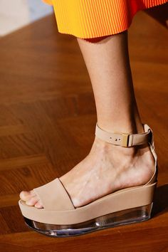 "STELLA MCCARTNEY S/S 2013: ""I question whether this is a take on the traditional Japanese sandal, or perhaps the coincidence is unintentional. The sole is made of LUCITE."""